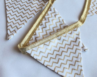 Sparkly gold foil chevron fabric  bunting on a gold lurex tape for  weddings and celebrations