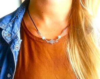Silver Hamsa hand necklace.