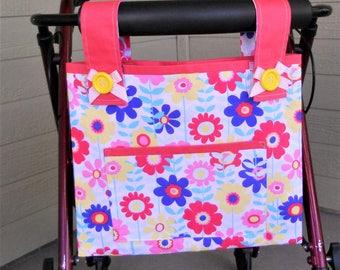 "Walker bag.  Walker Tote.  Bag for walker.  Bright floral fabric, bright pink lining.   Velcro closure. 15""W x 12""H.  Front pocket."