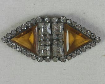 Vintage art deco belt clasp or dress clip, triangular faceted amber square and round rhinestones symmetric shape, very collectible.