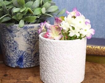 Vintage white vase or planter, relief embossed ceramic