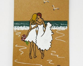 Hand coloured Mrs and Mrs Beach Wedding greetings card on recycled card couple love embrace beach theme Bride & Bride Lesbian wedding