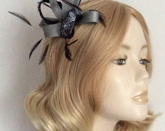 BLACK, and METALLIC PEWTER Fascinator, Made of sinamay, sequins,feathers, on a clip