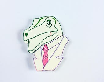 Buisness Raptor means business brooch. Handmade brooch by Outlaws and Skeletons. Velociraptor in a Suit Brooch Pin.