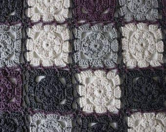 Plaid, crochet with flowers of cotton and polyester. Color grey, purple and cream.