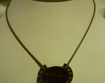C2 Vintage Gold Rhinestone Pendant on a Adjustable Chain.