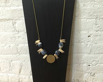 Shells, stones, and brass necklace