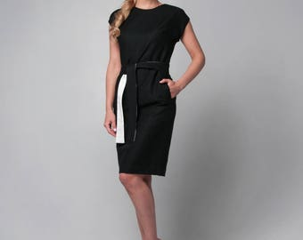 Black office dress with a two-color belt