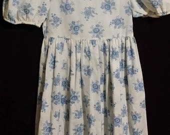 Adorable little girl vintage dress by RUTH, adorned with blue bouquets.
