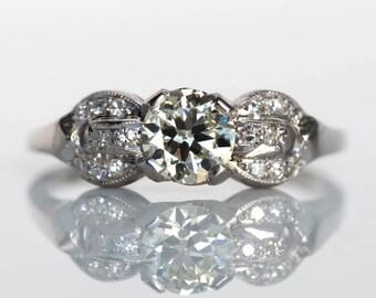 Circa 1920s Art Deco Platinum GIA Certified .58ct Round Brilliant Cut Diamond Engagement Ring with .15cttw Side Stones - VEG#726