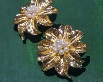 Vintage Poinsettia clip on earrings with pearl centers. Beautiful Holiday earrings.