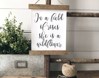 In a field of roses she is a wildflower - farmhouse style sign - baby room decor - wood poster hanger  - canvas wall banner with wood