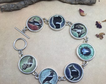 Witch's Familiar - glass picture bracelet. Witchcraft.