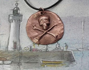 Steampunk gothic pirate pendant ; copper skull . You'll find it in white bronze in this shop .On commission copper red
