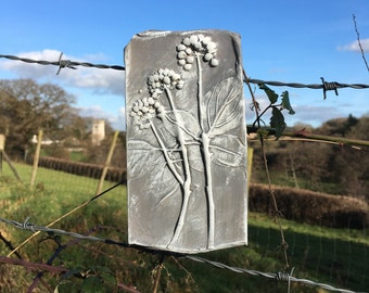 Rustic clay wall hanging, art, plaque, imprint of ivy seed heads, pale grey and white.