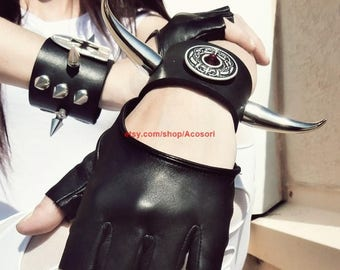 spiked leather cuffs with emerald and horns, Teutonic crosses