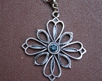 Silver necklace with star detail face gem