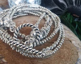 Empty beaded steel bracelet