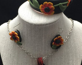 Flower pendant, earrings & necklace set.  Red, yellow, black, silver