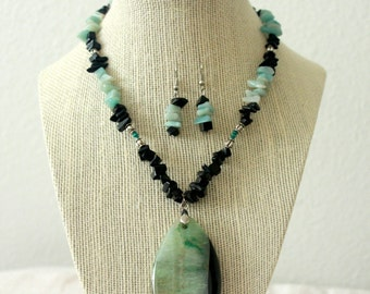 Turquoise necklace with lampworked glass pendant and matching earrings