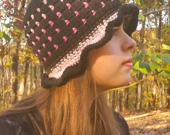 Black and pink women's cloche hat