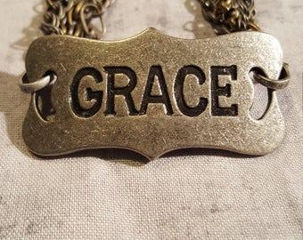 GRACE CHARM BRACELET - multi-stranded chain link clasps.