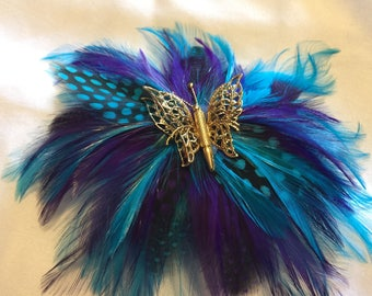 Blue and Purple flower feather barrette with decorative Golden Butterfly center piece