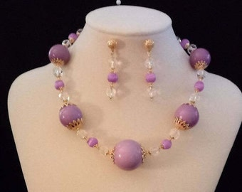 This is a one of a kind Primary Lavender beads with goldtone bead caps