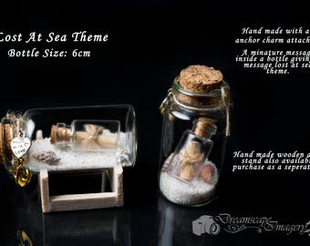 Small handmade miniature message in a bottle lost at sea