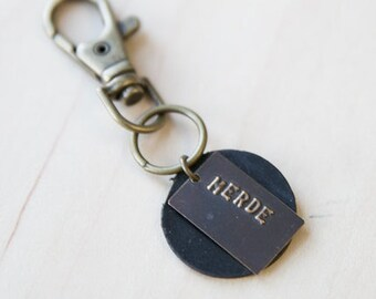 MERDE  Stamped Metal Keychain