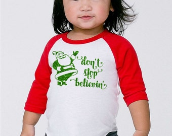 Don't Stop Believing Santa Claus Christmas Shirt- Funny Holiday Outfit- Baby's first Christmas Gift- Children Infant Toddler Raglan- #054