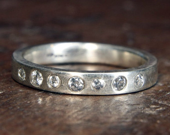 Recycled sterling silver & moissanite 3mm wide satin finish eternity or wedding ring. Hand made to order in the UK.