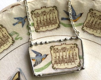 Recycled china necklace. Broken china jewelry necklace antique 1916 calendar plate - June 1916 bluebird
