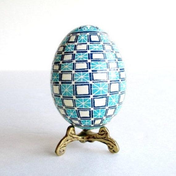 Blue Pysanka batik egg on chicken egg shell Ukrainian Easter egg, hand painted egg