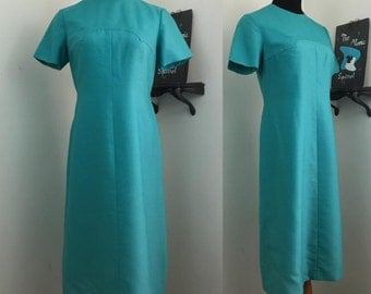 Turquoise Twist // 1960s Blue Dress with Bust Detail