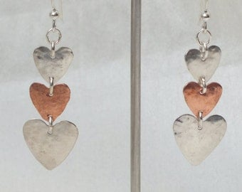 sterling silver hearts with copper heart inbetween