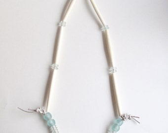 Long beaded necklace with cream bone beads, horn, and aqua blue and clear glass beads on thick silver leather cord An Astrid Endeavor