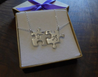 Two Silver Puzzles with Script Initials