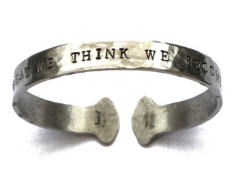 Quote bangle 'What We Think We Become' Hand stamped aluminium ladies bracelet