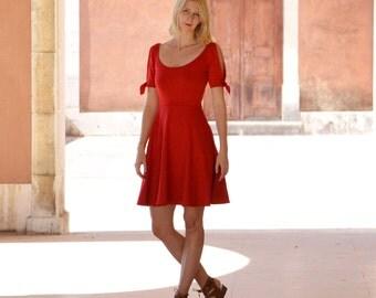 Nanette Split Sleeve Jersey Scoop Neck Red Summer Dress. Vintage Style Cold Shoulder Skater Dress with Wide Neck and Tie Up Detail