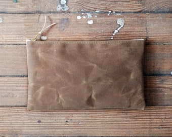 Zipper pouch in durable saddle brown waxed canvas.