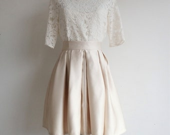 Short top in lace and pleated silk skirt wedding dress