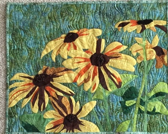 Quilted floral wall hanging.  Art quilt.  Fiber arts. Thread painting.