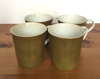 Tawny green coffee cups made for Marshall Fields and Company by Mikasa