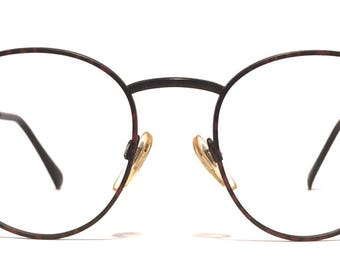 Vintage eyewear. Valentino. Made in Italy 1980's. Excellent quality and condition! Deep red and black color. Great round shape! Cool