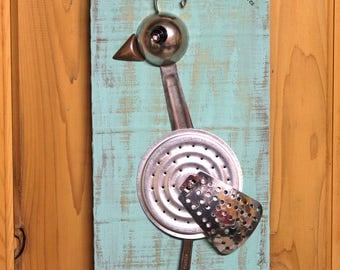 """Metal art, exotic, bird wall hanging made from found object, re-purposed materials. Whimsical, unique folk art. """"Pretty Polly"""""""