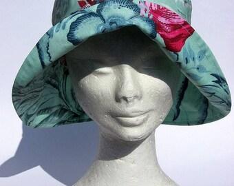 women's rain hat, rain, waterproof, all weather, light blu ,flowers design, large brime