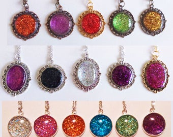 Glitter design cabochon bezel/cameo style necklaces.Only one available of each, choose which one you would like from the dropdown menu.