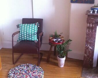 Green pompoms cushion