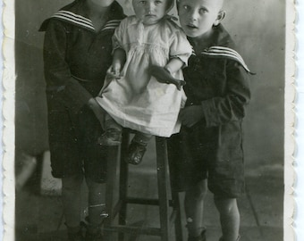 Old snapshot, vintage photo, Russia 1940s, two little boys, twins, in sailor suits hugging little sister, boy and girl photo, children photo